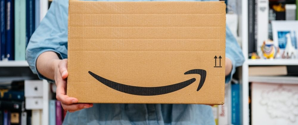 Person holding a box from Amazon. Photo: Shutterstock