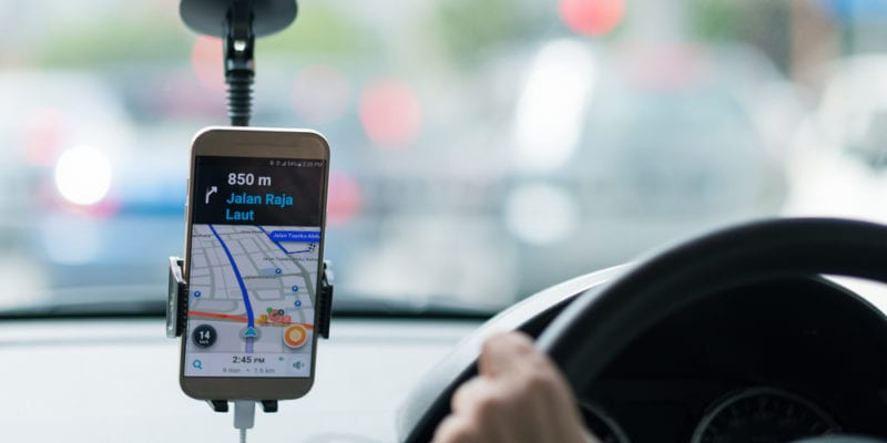 Uber app on smartphone and driver