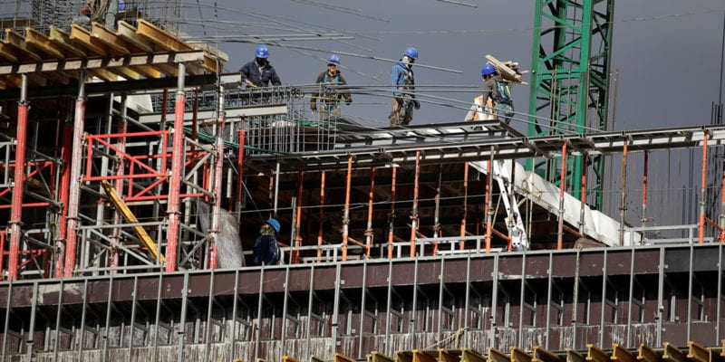 Workers are seen in a building undergoing construction in Mexico City